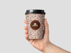 Hand Holding Coffee Cup – Free PSD Mockup