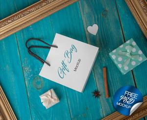 Gift Bag On Wooden Blue Background Mockup