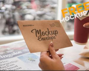 Closeup of Woman Hand Opening Envelope Free mockup