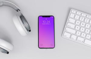 iPhone x Mockup on a Workspace Free Mockup