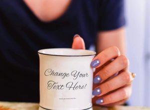 Hand Holding Mug Free Mockup