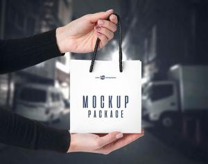 3 Little Bags in Hands Free Mockup