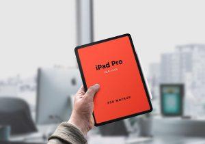 iPad Pro in Man's Hand Free Mockup