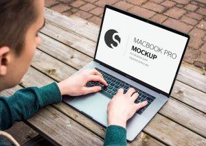 Men Working on MacBook Pro Free Mockup