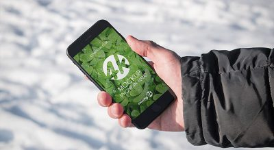 Free iPhone in Hand Mockup