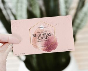 Free Girl Holding PSD Business Card Mockup