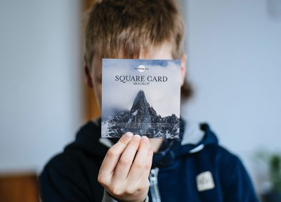 Free Little Boy Showing Square Card Mockup