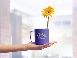 Free Mug on Female Hand Mockup