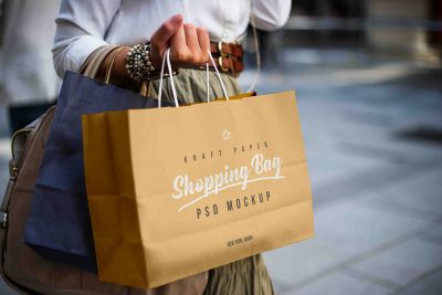 Female Holding Kraft Paper Shopping Bag Mockup