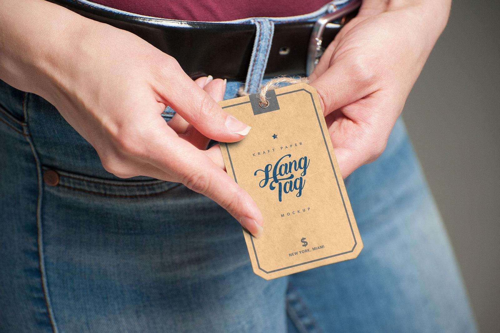Hand Holding Kraft Paper Hang Tag Free Mockup