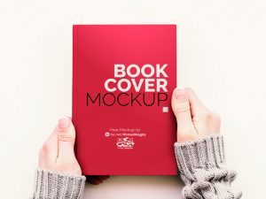 Hand Held Book Cover Free Mockup