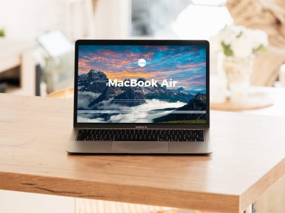 Free Interior MacBook Air on Table Mockup