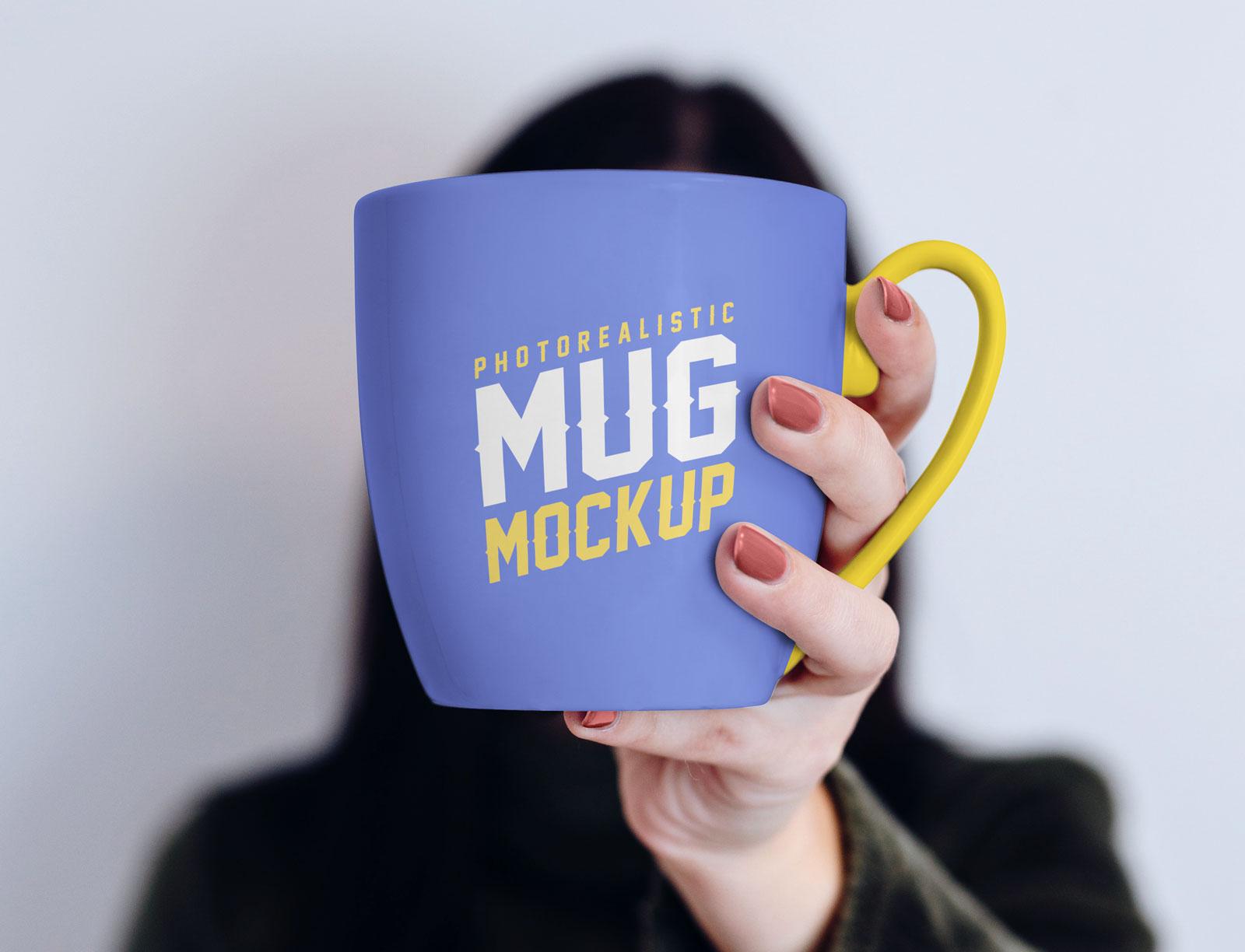 Mug in Female Hand Free PSD Mockup