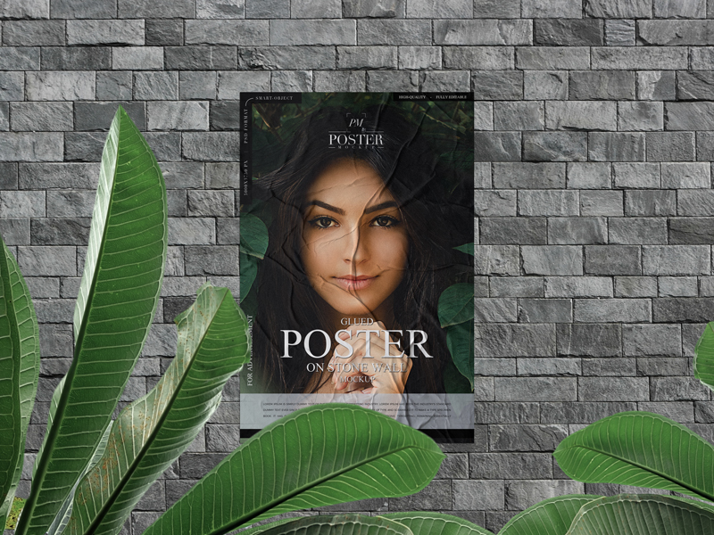 Glued Poster on Stone Wall - Free PSD Mockup