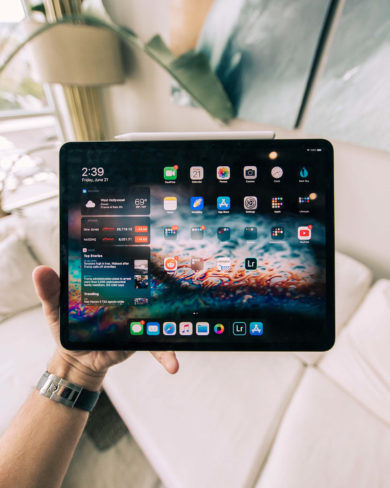 Free Tablet in Hand Mockup