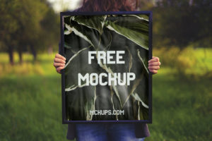Free Woman Holding Square Poster Mockup
