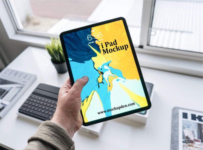 Man Using iPad Free PSD Mockup Template