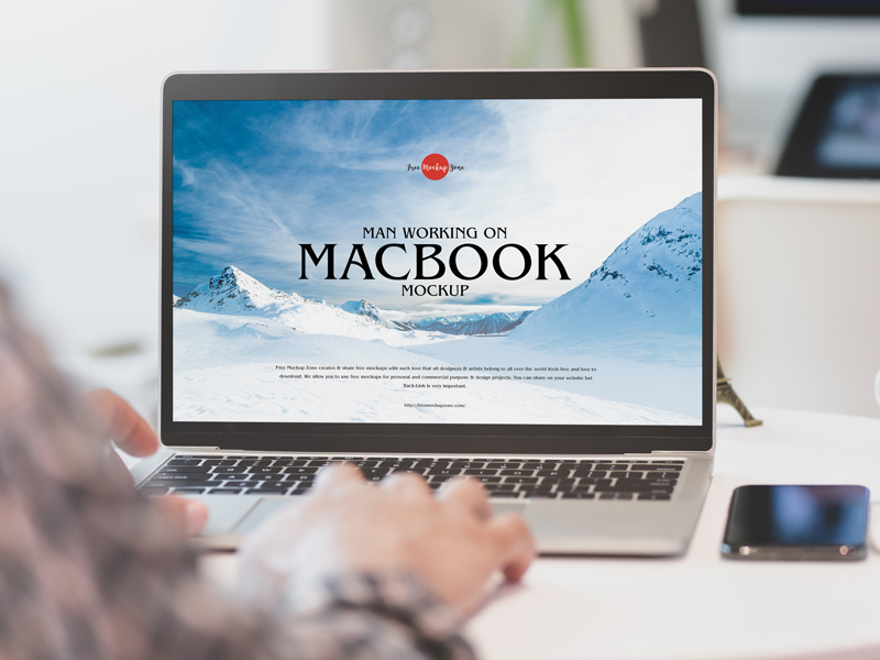 Man Working on MacBook Free PSD Mockup