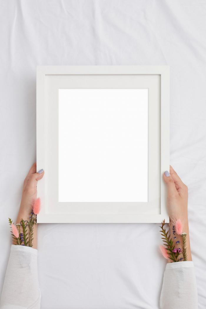 Photo Frame Holding Free PSD Mockup