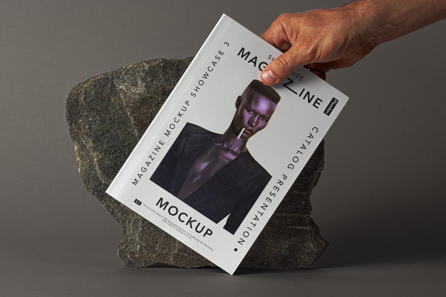 Hand Holding Magazine Free PSD Mockup