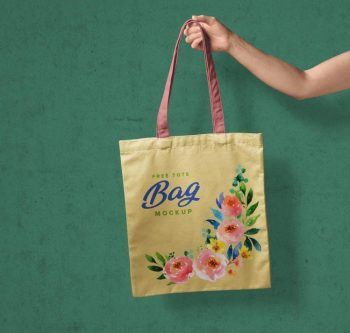 Hand Holding Tote Shopping Bag Mockup