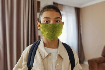 Little Girl Wearing a Face Mask Free (PSD) Mockup