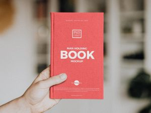 Man Holding Book Free (PSD) Mockup
