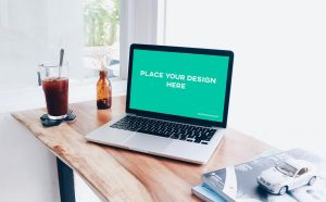 Free Laptop on Desk Mockup