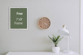 Free (PSD) Poster Frame On Room Mockup