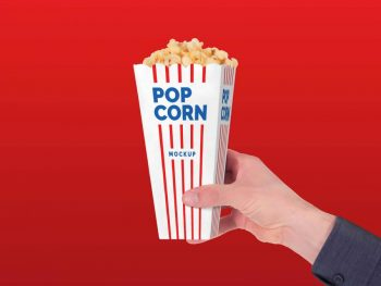 Free Holding Popcorn Paper Box Mockup