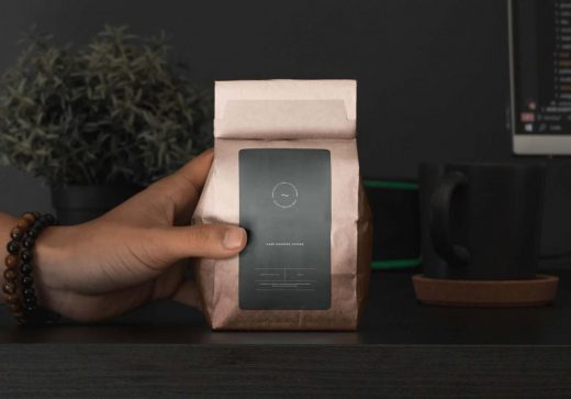 Free Hand Holding Coffee Packaging Mockup