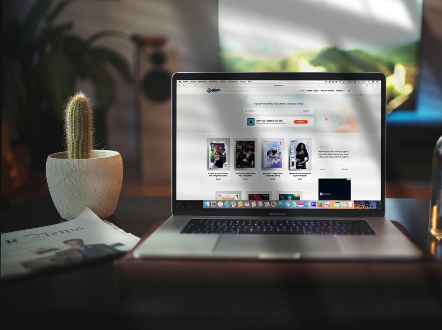 Free Macbook Pro on Desk Mockup (PSD)
