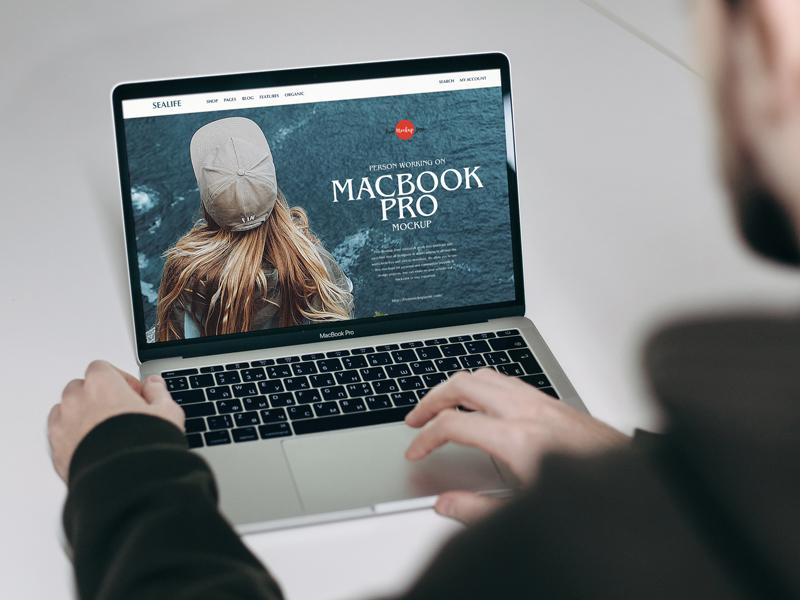 Person Working on MacBook Pro Free Mockup