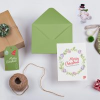 Free Christmas Greeting Card Mockup (PSD)