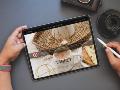 Free Designer Working on Tablet Mockup