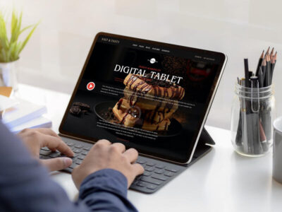 Free Person Working on Digital Tablet Mockup