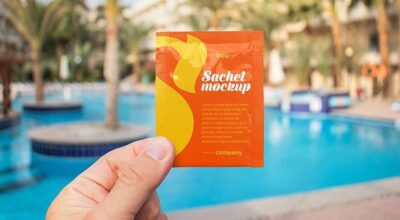 Free Sachet in a Hand Mockup (PSD)
