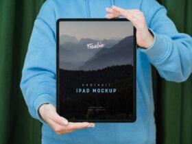 Free Hand Holding iPad Pro Mockup
