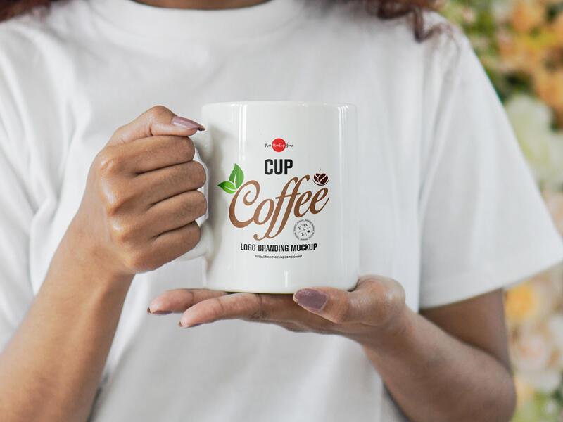 Free Girl Holding Coffee Cup Mockup