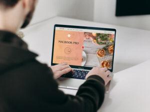 Man Using MacBook Pro Free Mockup