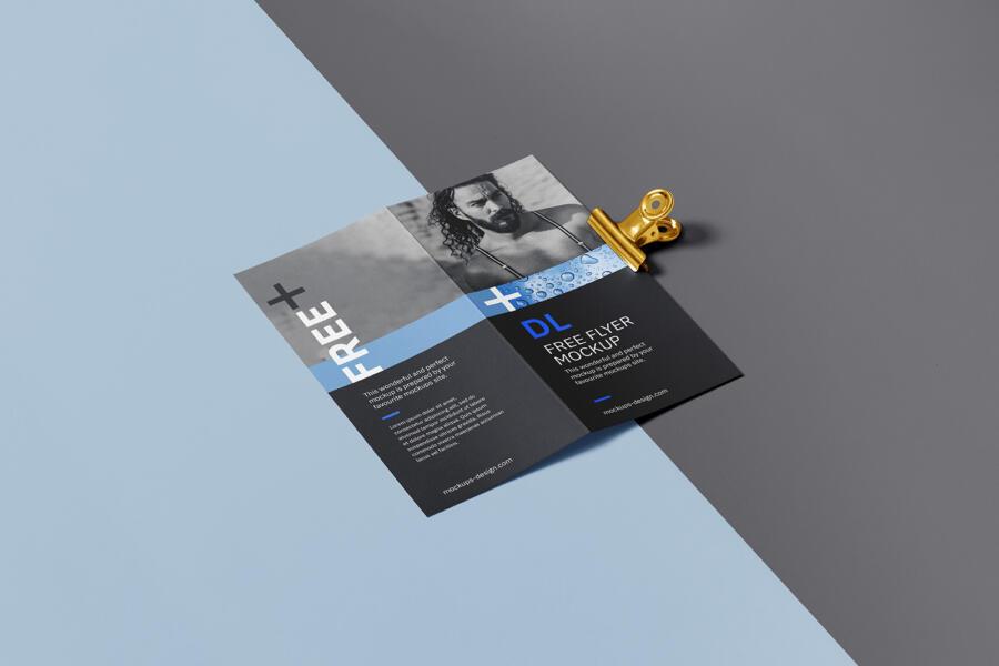 Bi fold DL Flyer with a clip Free Mockup