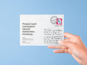 Hand Holding Postal Card Free Mockup