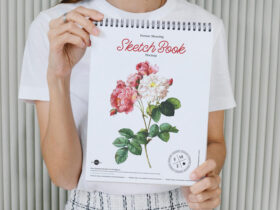 Person Showing Sketch Book Free Mockup